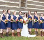 Bridal part and bride in front of cabin at Destarte Wedding Venue and Barn in North Carolina